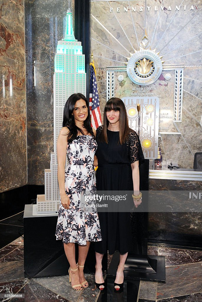 Actress Torrey DeVitto and Women's Health magazine ediotor-in-chief Amy Laird attend the lighting of The Empire State Building green on behalf of The Hope & Grace Initiative in honor of Mental Health Awareness on May 2, 2016 in New York City.