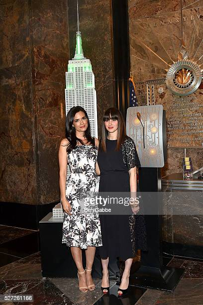 Actress Torrey Devitto and Women's Health magazine editorinchief Amy Laird light The Empire State Building Green In Honor Of Mental Health Month on...