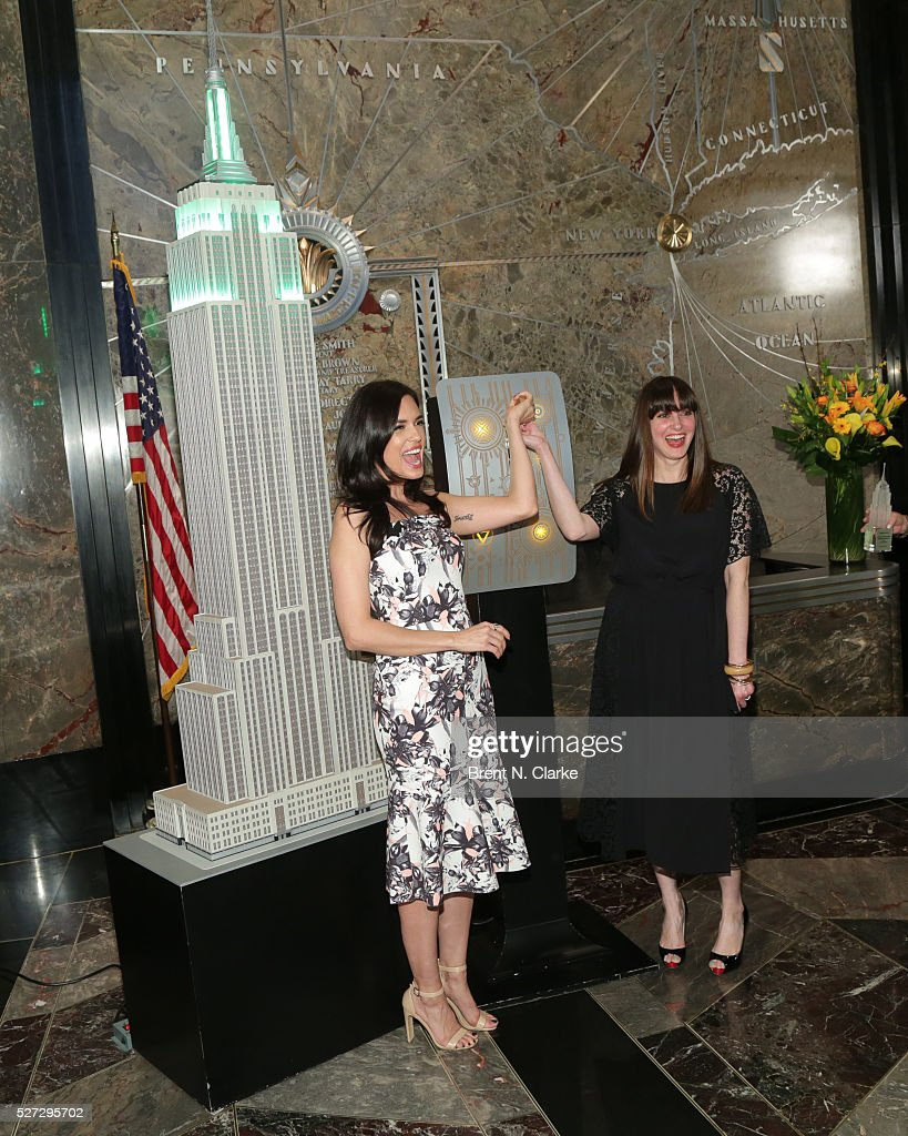 Actress Torrey DeVitto (L) and Women's Health magazine editor-in-chief Amy Laird pose for photographs before lighting The Empire State Building green in honor of Mental Health Month at The Empire State Building on May 2, 2016 in New York City.