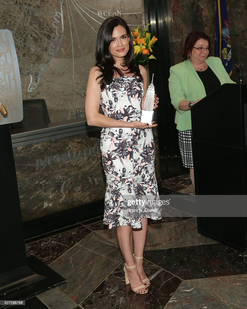 Actress Torrey DeVitto poses for photographs before lighting The Empire State Building green in honor of Mental Health Month at The Empire State Building on May 2, 2016 in New York City.