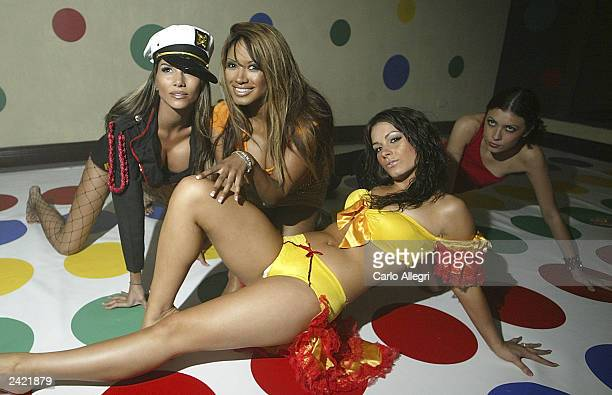 Actress Traci Bingham plays twister with models in the Twister room at the 2nd Annual BETonSPORTScom Carnival Party August 23 2003 in San Jose Costa...