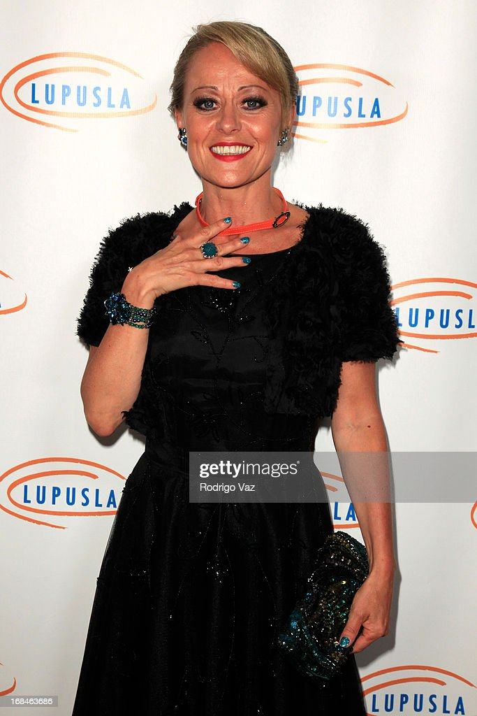Actress <a gi-track='captionPersonalityLinkClicked' href=/galleries/search?phrase=Tracie+Bennett&family=editorial&specificpeople=2978909 ng-click='$event.stopPropagation()'>Tracie Bennett</a> arrives at the 13th Annual Lupus LA Orange Ball at the Beverly Wilshire Four Seasons Hotel on May 9, 2013 in Beverly Hills, California.