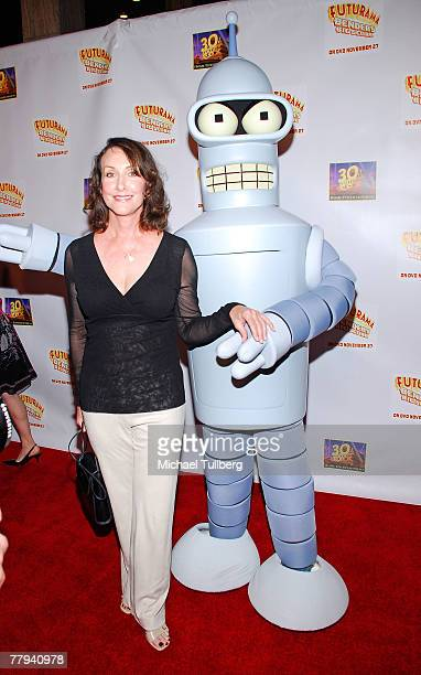 Actress Tress MacNeille poses with 'Futurama' character Bender The Robot at the premiere screening of the new DVD 'Futurama Bender's Big Score' at...