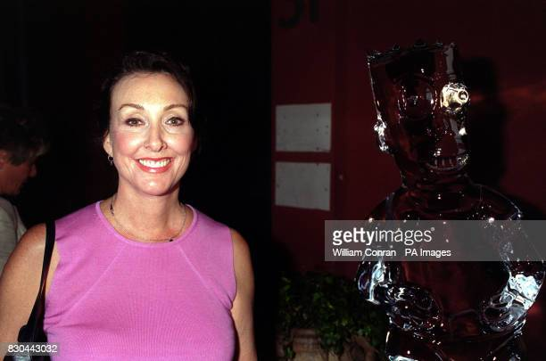 Actress Tress MacNeille the voice of Mrs Skinner and the stand in for Marge Simpson with an ice sculpture of Bart Simpson inside the MOMO bar in...