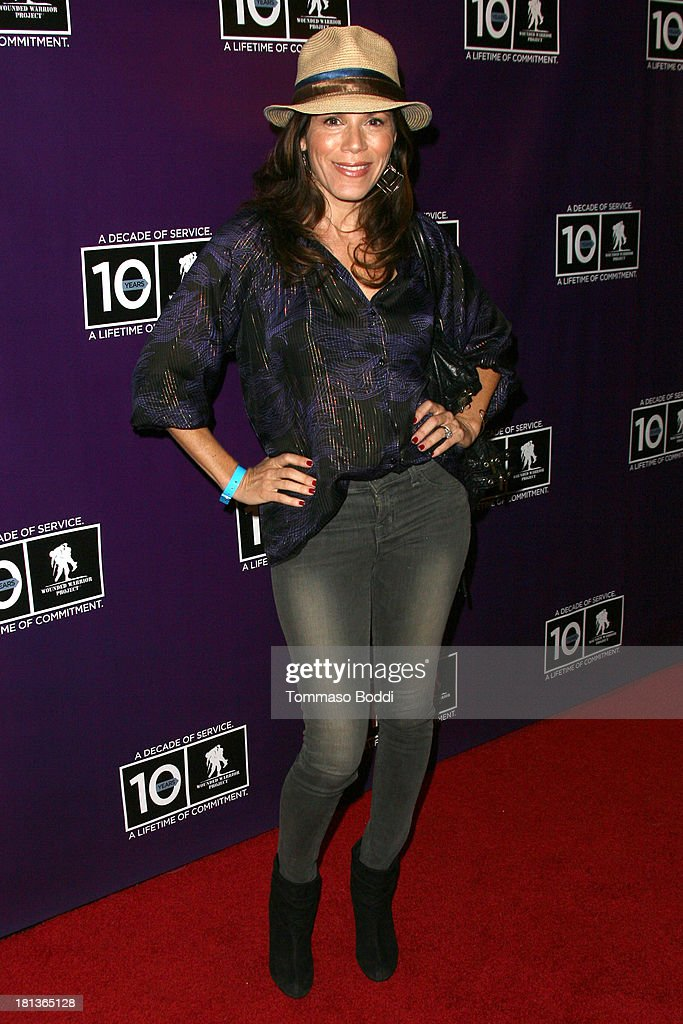Actress Tricia Fisher attends the Wounded Warrior Project style and beauty charity event held at Avalon on September 20, 2013 in Hollywood, California.