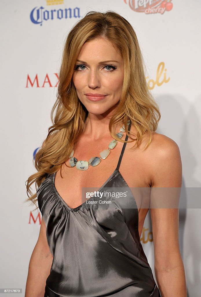 Actress Tricia Helfer arrives at Maxim's 10th Annual Hot 100 Celebration Presented by Dr Pepper Cherry, True Religion Brand Jeans, Stolichnaya Vodka and Corona held at Barker Hangar on May 13, 2009 in Santa Monica, California.