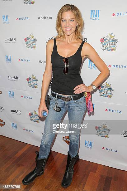 Actress Tricia Helfer arrives at the 6th annual Kiehl's LifeRide for amfAR celebration at Kiehl's Since 1851 on August 12 2015 in Santa Monica...
