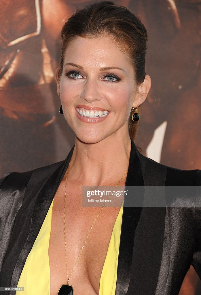 Actress <a gi-track='captionPersonalityLinkClicked' href=/galleries/search?phrase=Tricia+Helfer&family=editorial&specificpeople=227945 ng-click='$event.stopPropagation()'>Tricia Helfer</a> arrives at the Los Angeles premiere of 'Riddick' at the Westwood Village Theatre on August 28, 2013 in Westwood, California.