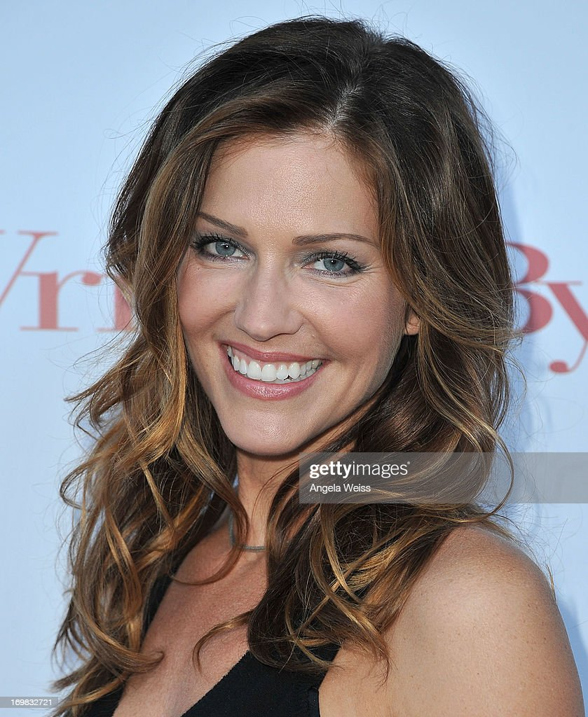Actress <a gi-track='captionPersonalityLinkClicked' href=/galleries/search?phrase=Tricia+Helfer&family=editorial&specificpeople=227945 ng-click='$event.stopPropagation()'>Tricia Helfer</a> arrives at WGA's tribute event to unveil '101 Best Written TV Series' at Writers Guild Theater on June 2, 2013 in Beverly Hills, California.