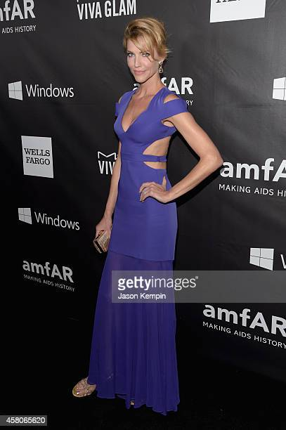 Actress Tricia Helfer attends the 2014 amfAR LA Inspiration Gala at Milk Studios on October 29 2014 in Hollywood California