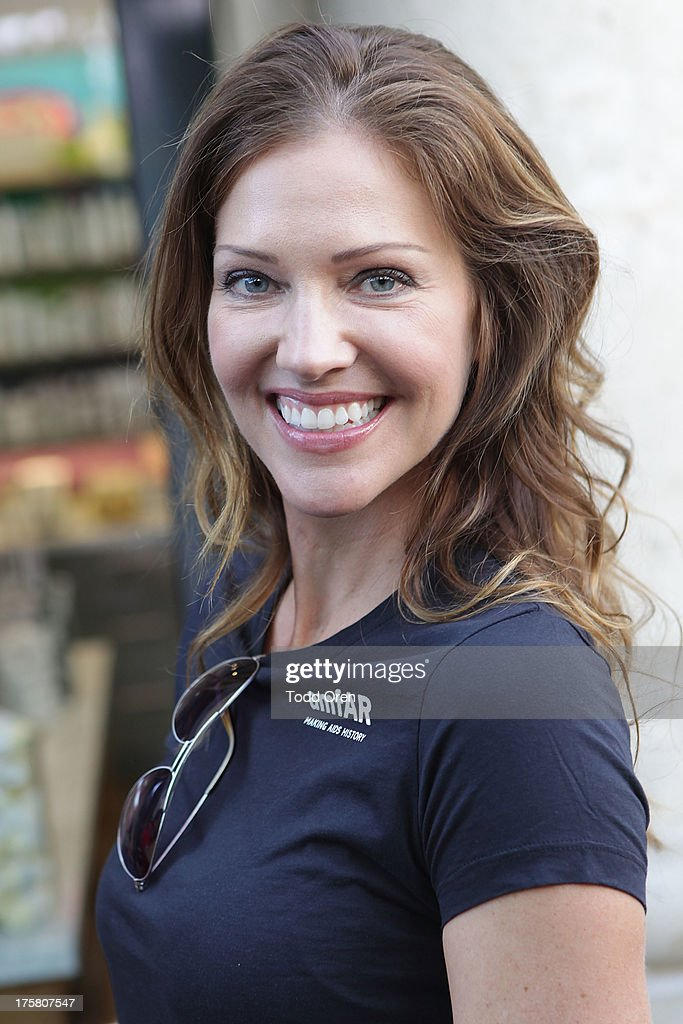 Actress <a gi-track='captionPersonalityLinkClicked' href=/galleries/search?phrase=Tricia+Helfer&family=editorial&specificpeople=227945 ng-click='$event.stopPropagation()'>Tricia Helfer</a> poses at the Kiehl's Since 1851 Liferide for amfAR at The Grove on August 8, 2013 in Los Angeles, California.