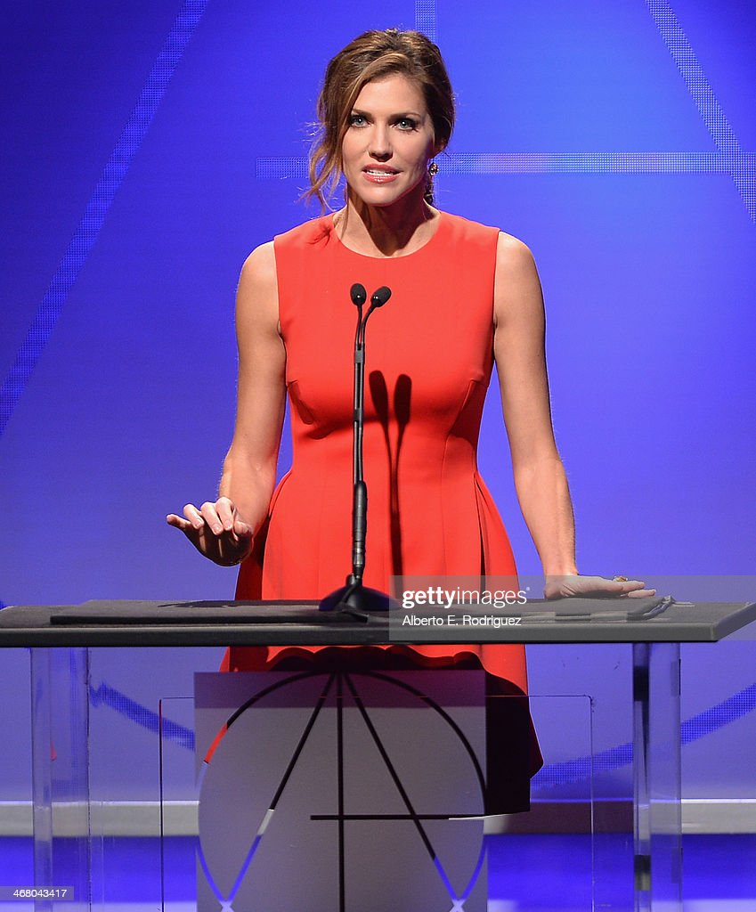 Actress <a gi-track='captionPersonalityLinkClicked' href=/galleries/search?phrase=Tricia+Helfer&family=editorial&specificpeople=227945 ng-click='$event.stopPropagation()'>Tricia Helfer</a> speaks on stage atthe 18th Annual Art Directors Guild Exellence In Production Design Awards at The Beverly Hilton Hotel on February 8, 2014 in Beverly Hills, California.