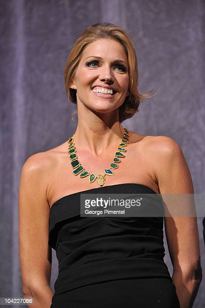 Actress Tricia Helfer stands onstage at 'A Beginner's Guide To Endings' Premiere introduction during the 35th Toronto International Film Festival at...