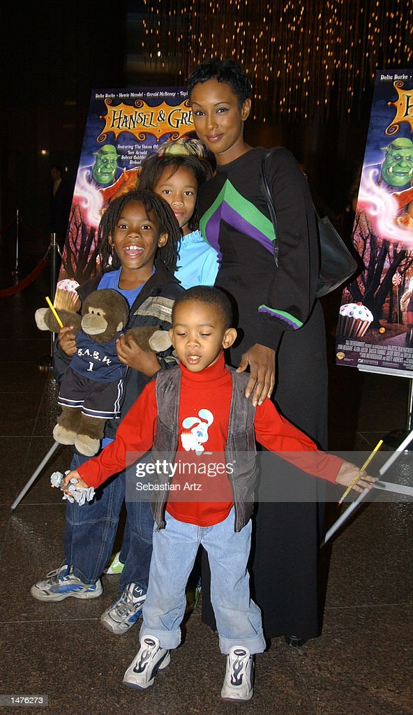 Actress Trina McGee-Davis arrives with her children at the premiere of the movie 'Hansel & Gretel' on October 14, 2002 in Los Angeles, California.