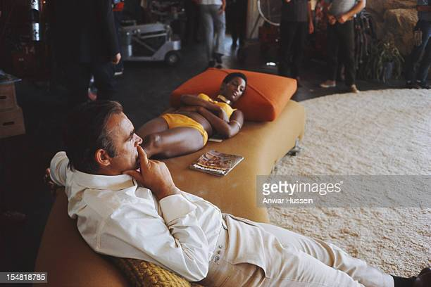 Actress Trina Parks and Scottish actor Sean Connery relax between takes on the set of the James Bond film 'Diamonds Are Forever' USA 1971 They are...