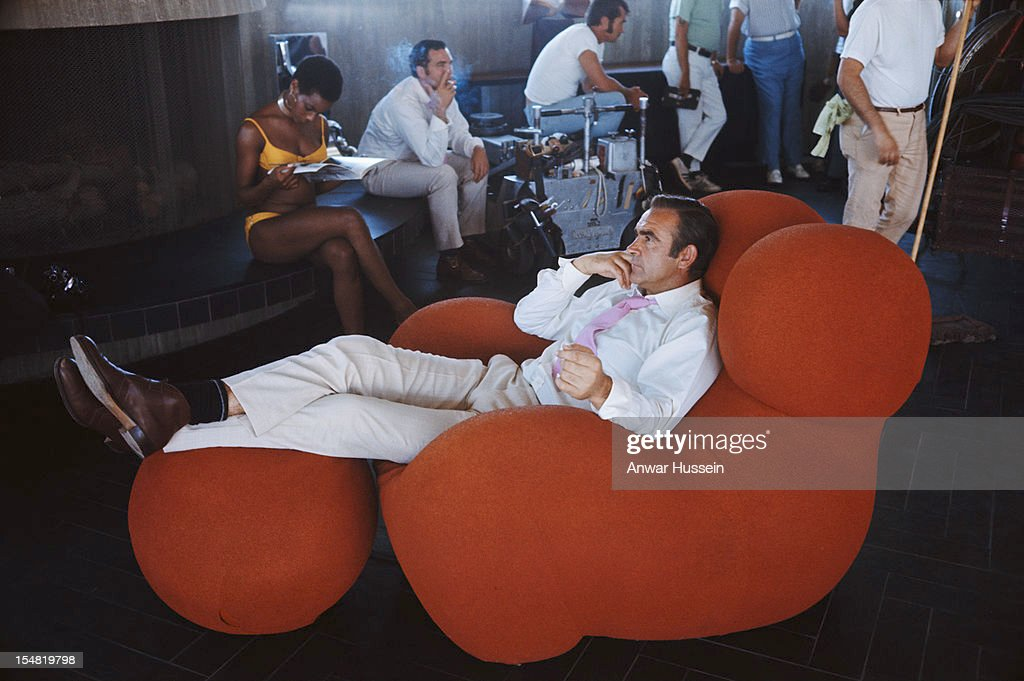 Actress Trina Parks and Scottish actor Sean Connery relax between takes on the set of the James Bond film 'Diamonds Are Forever' USA 1971 They are on...
