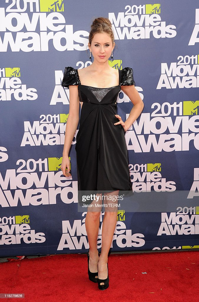 Actress Troian Bellisario arrives at the 2011 MTV Movie Awards at Universal Studios' Gibson Amphitheatre on June 5, 2011 in Universal City, California.