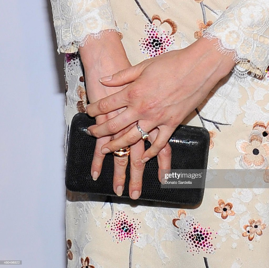 Actress <a gi-track='captionPersonalityLinkClicked' href=/galleries/search?phrase=Troian+Bellisario&family=editorial&specificpeople=6886214 ng-click='$event.stopPropagation()'>Troian Bellisario</a> (ring detail) attends MaxMara And W Magazine Cocktail Party To Honor The Women In Film MaxMara Face Of The Future, Rose Byrne at Chateau Marmont on June 10, 2014 in Los Angeles, California.