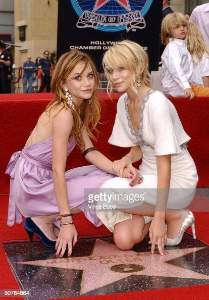 Actress twins Ashley and MaryKate Olsen attend the ceremony honoring them with a star on the Hollywood Walk of Fame on April 29 2004 in Hollywood...