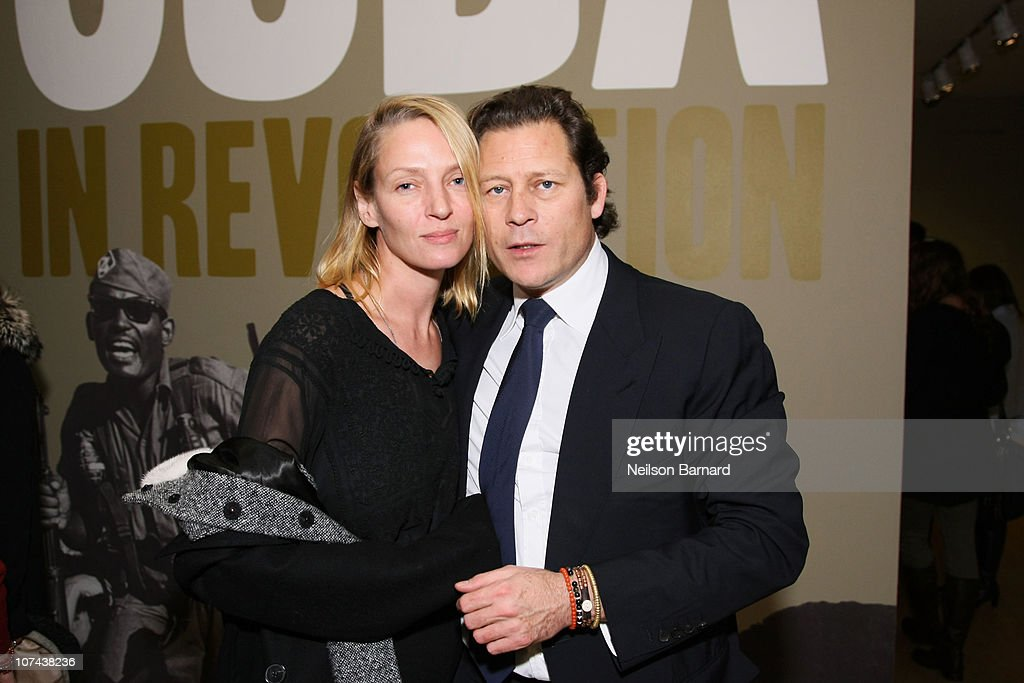 Actress Uma Thurman and chairman of EIM Group and The International Art Heritage Foundation Arpad 'Arki' Busson pose during the after-party for Arpad Busson, The International Art Heritage Foundation and the International Center of Photography host a panel discussion moderated by ABC anchor Christiane Amanpour as part of the ICP exhibit, Cuba In Revolution at International Center of Photography on December 8, 2010 in New York City.