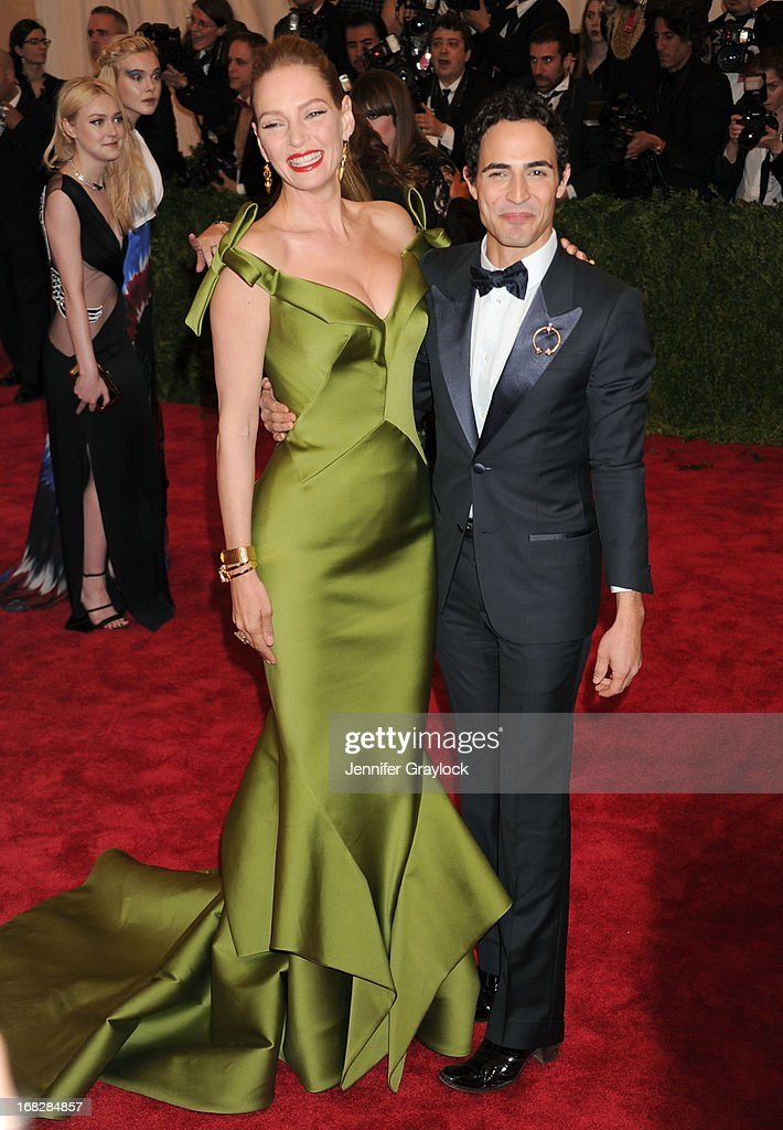 Actress Uma Thurman and Fashion designer Zac Posen attend the Costume Institute Gala for the 'PUNK: Chaos to Couture' exhibition at the Metropolitan Museum of Art on May 6, 2013 in New York City.