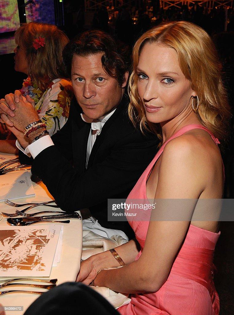 Actress Uma Thurman and guest during the 10th Annual White Tie and Tiara Ball to Benefit the Elton John Aids Foundation in association with Chopard held at Sir Elton John's home on June 26, 2008 in Old Windsor, England.