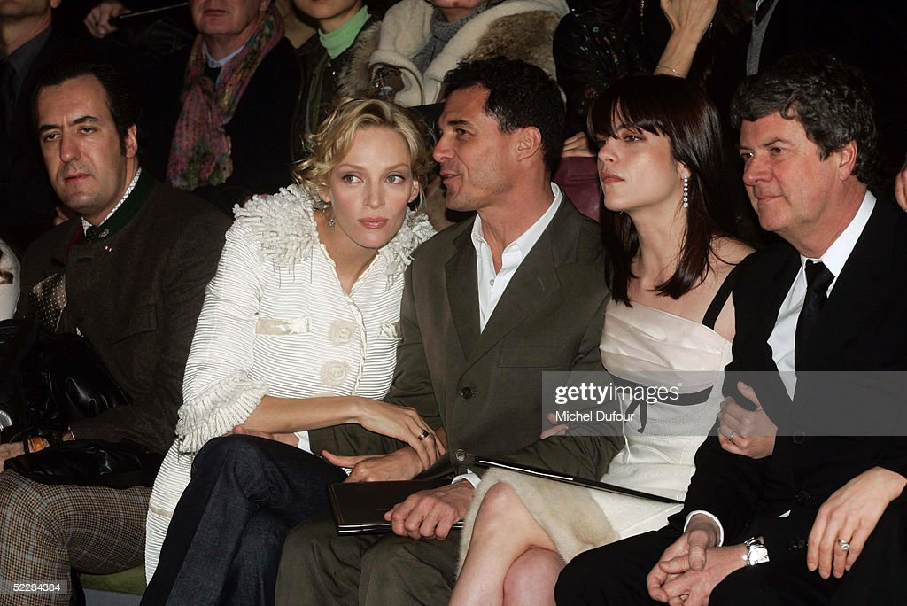 Actress Uma Thurman and her boyfriend Andre Balazs attend the Louis Vuitton fashion show with actress Selma Blair and Yves Carcelle during Paris...