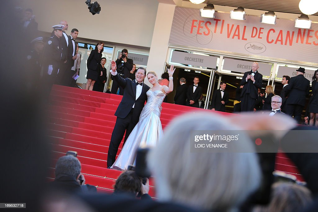US actress Uma Thurman (R) and her partner French businessman Arpad Busson pose on May 26, 2013 as they arrive for the screening of the film 'Zulu' presented Out of Competition at the 66th edition of the Cannes Film Festival in Cannes. AFP PHOTO / LOIC VENANCE