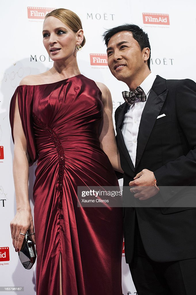 Actress Uma Thurman (L) and Hong Kong actor Donnie Yen (R) attend at the Moet & Chandon and FilmAid Asia Power of Film Gala at Clear Water Bay Film Studios on March 16, 2013 in Hong Kong, Hong Kong.