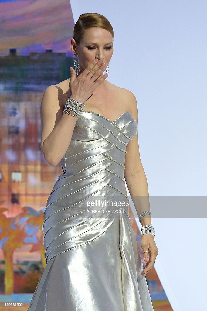 US actress Uma Thurman arrives on stage on May 26, 2013 to hand the Palme d'Or award during the closing ceremony of the 66th Cannes film festival in Cannes.