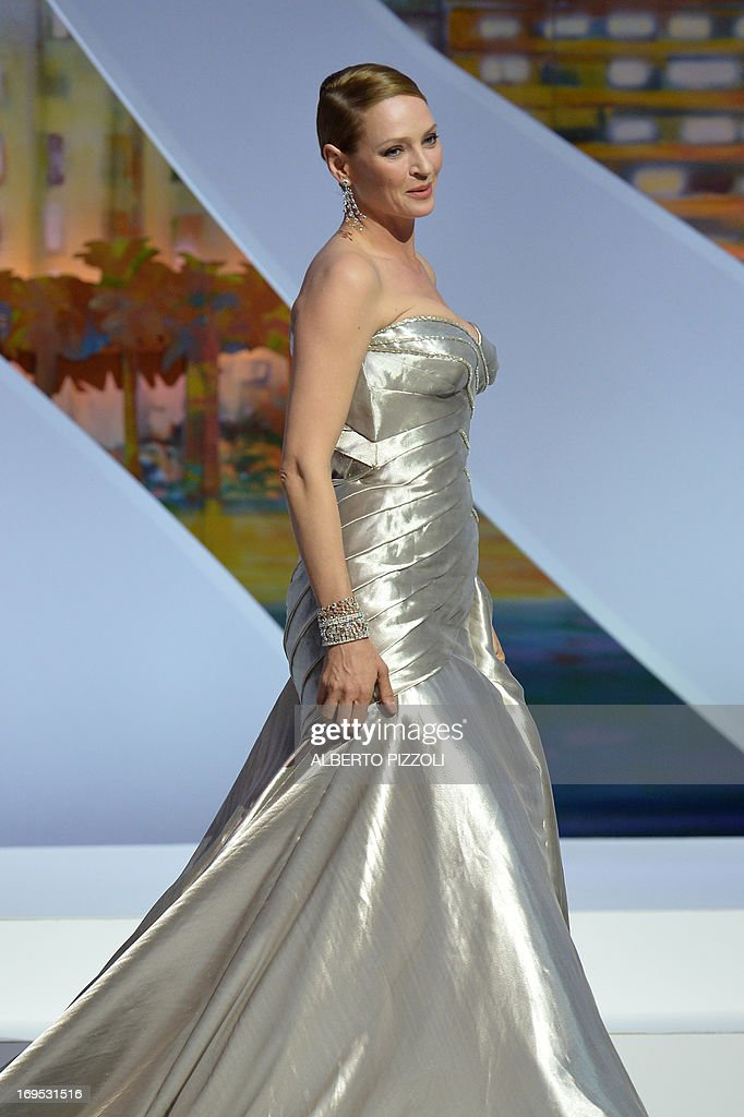 US actress Uma Thurman arrives on stage on May 26, 2013 to hand the Palme d'Or award during the closing ceremony of the 66th Cannes film festival in Cannes. AFP PHOTO / ALBERTO PIZZOLI