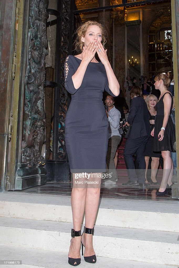 Actress <a gi-track='captionPersonalityLinkClicked' href=/galleries/search?phrase=Uma+Thurman&family=editorial&specificpeople=171973 ng-click='$event.stopPropagation()'>Uma Thurman</a> arrives to attend the Versace show as part of Paris Fashion Week Haute-Couture Fall/Winter 2013-2014 on June 30, 2013 in Paris, France.