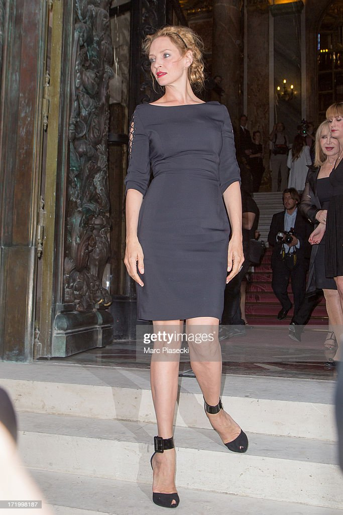 Actress Uma Thurman arrives to attend the Versace show as part of Paris Fashion Week Haute-Couture Fall/Winter 2013-2014 on June 30, 2013 in Paris, France.