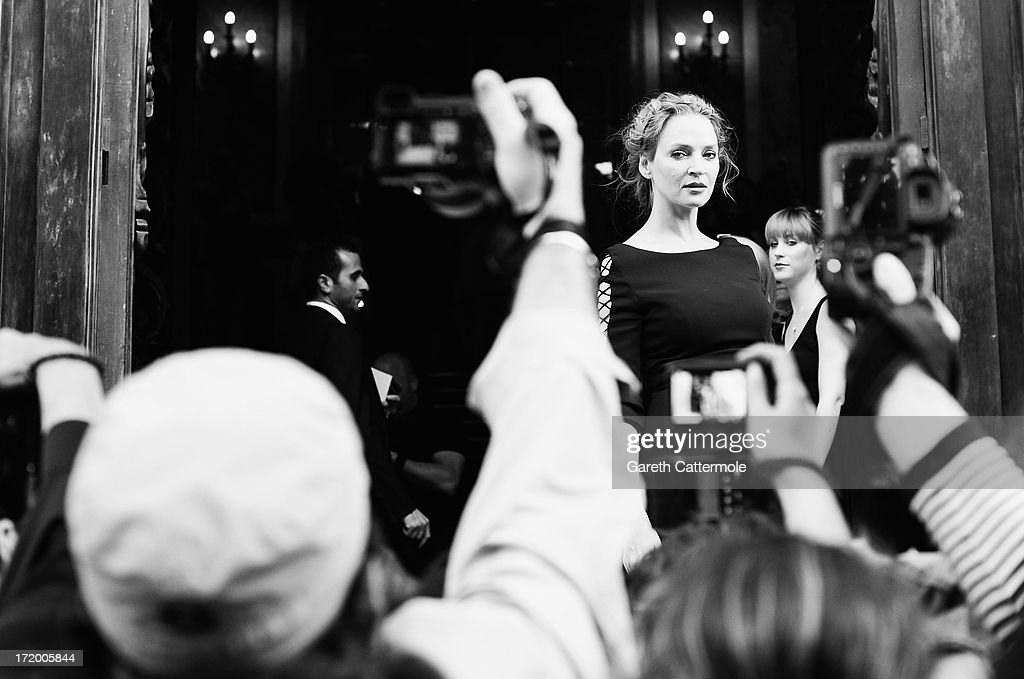 Actress <a gi-track='captionPersonalityLinkClicked' href=/galleries/search?phrase=Uma+Thurman&family=editorial&specificpeople=171973 ng-click='$event.stopPropagation()'>Uma Thurman</a> attends the Versace show as part of Paris Fashion Week Haute-Couture Fall/Winter 2013-2014 at on June 30, 2013 at the Chambre de Commerce et d'Industrie, 25 avenue Friedland in Paris, France.