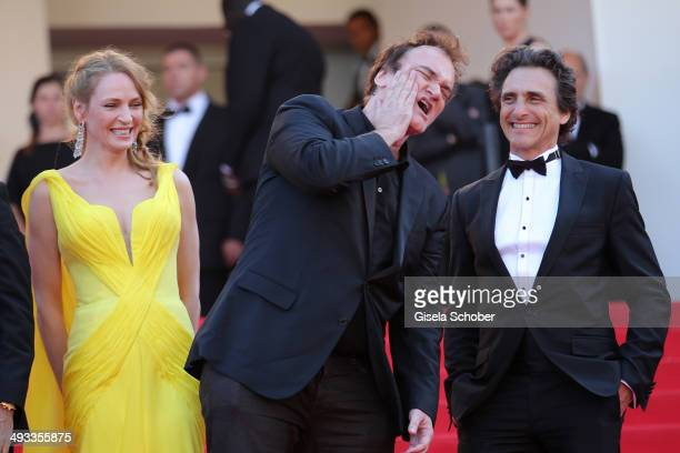 Actress Uma Thurman director Quentin Tarantino and producer Lawrence Bender attend the 'Clouds Of Sils Maria' premiere during the 67th Annual Cannes...
