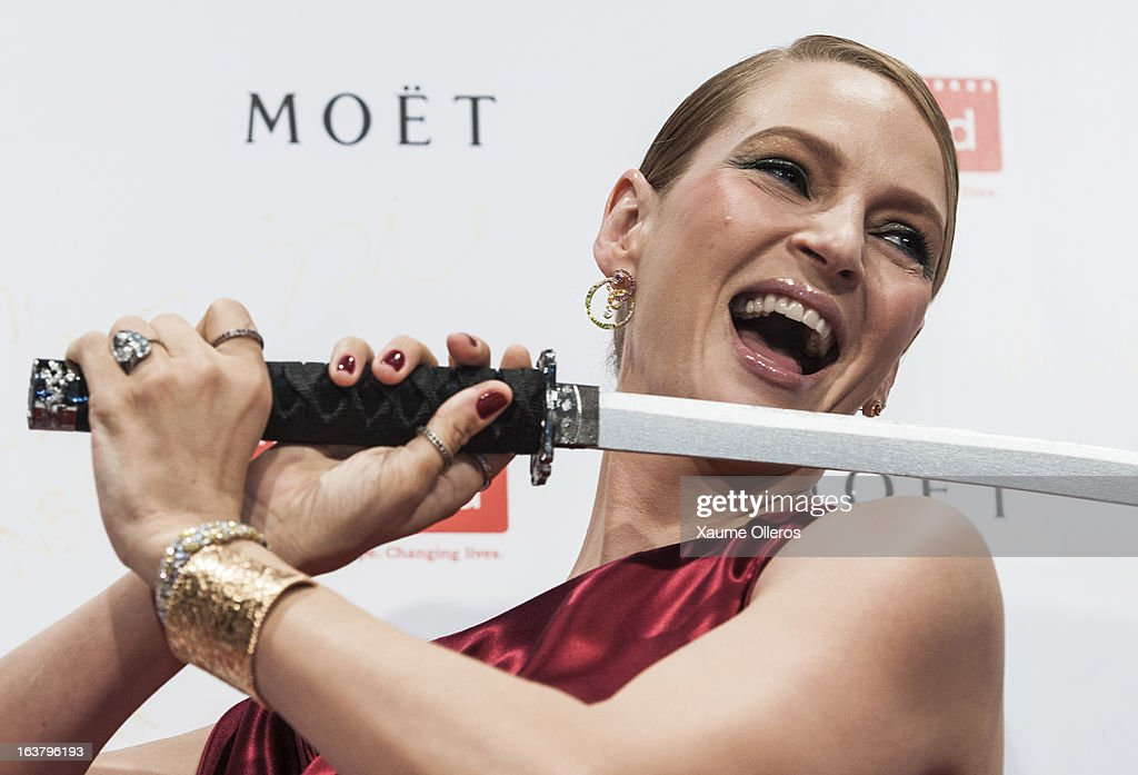 Actress <a gi-track='captionPersonalityLinkClicked' href=/galleries/search?phrase=Uma+Thurman&family=editorial&specificpeople=171973 ng-click='$event.stopPropagation()'>Uma Thurman</a> jokes at the Moet & Chandon and FilmAid Asia Power of Film Gala at Clear Water Bay Film Studios on March 16, 2013 in Hong Kong, Hong Kong.