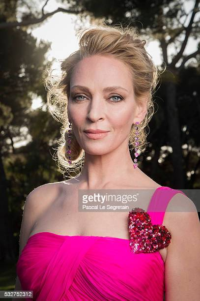 Actress Uma Thurman poses for photographs at the amfAR's 23rd Cinema Against AIDS Gala at Hotel du CapEdenRoc on May 19 2016 in Cap d'Antibes France