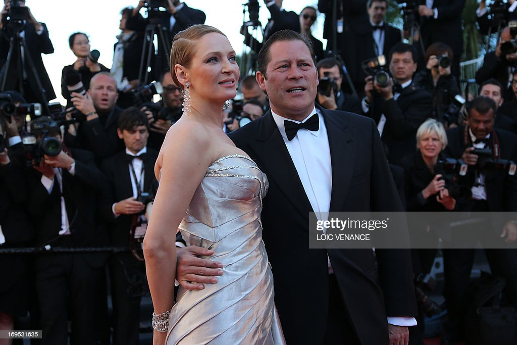 US actress Uma Thurman (L) poses on May 26, 2013 with her partner French businessman Arpad Busson as they arrive for the screening of the film 'Zulu' presented Out of Competition at the 66th edition of the Cannes Film Festival in Cannes. AFP PHOTO / LOIC VENANCE