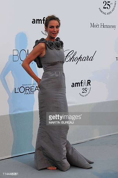 US actress Uma Thurman poses upon arrival to the 2011 amfAR's Cinema Against AIDS Benefit Gala on the sidelines of the 64th Cannes Film Festival on...