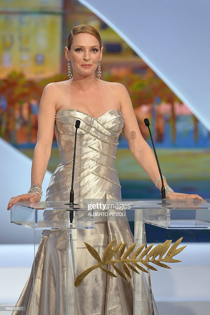 US actress Uma Thurman speaks on stage on May 26, 2013 before handing the Palme d'Or award during the closing ceremony of the 66th Cannes film festival in Cannes. AFP PHOTO / ALBERTO PIZZOLI
