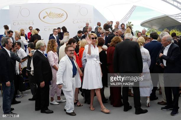 US actress Uma Thurman waves on May 23 2017 as she attends a photocall for the '70th Anniversary' of the Cannes Film Festival in Cannes southern...