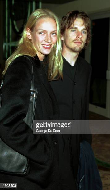 Actress Uma Thurman with her husband actor Ethan Hawke pose for photographers October 18 2000 at the 10th Anniversary Gala Benefit of Doctors of the...