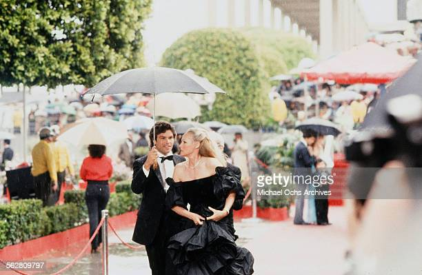 Actress Ursula Andress with actor Harry Hamlin arrive to the 54th Academy Awards at Dorothy Chandler Pavilion in Los AngelesCalifornia