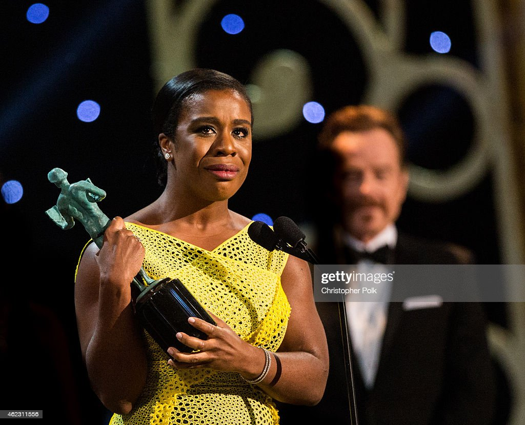 Actress Uzo Aduba accepts the award for Outstanding Performance by a Female Actor in a Comedy Series during TNT's 21st Annual Screen Actors Guild Awards at The Shrine Auditorium on January 25, 2015 in Los Angeles, California. 25184_013