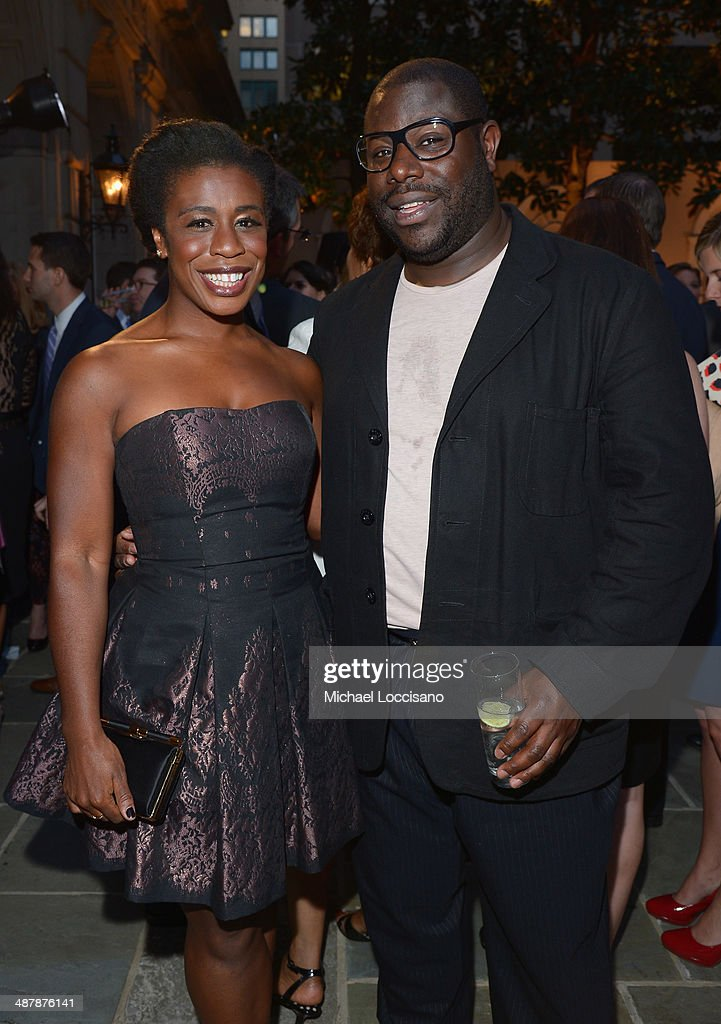 Actress <a gi-track='captionPersonalityLinkClicked' href=/galleries/search?phrase=Uzo+Aduba&family=editorial&specificpeople=7042411 ng-click='$event.stopPropagation()'>Uzo Aduba</a> and director Steve McQueen attend the PEOPLE/TIME WHCD cocktail party at St Regis Hotel - Astor Terrace on May 2, 2014 in Washington, DC.