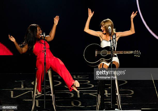 Actress Uzo Aduba and singersongwriter Taylor Swift perform onstage during Taylor Swift The 1989 World Tour Live In Los Angeles at Staples Center on...