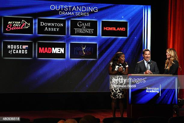 Actress Uzo Aduba CEO of the Academy of Television Arts Sciences Bruce Rosenblum and TV personality Cat Deeley present the 67th Primetime Emmy Awards...