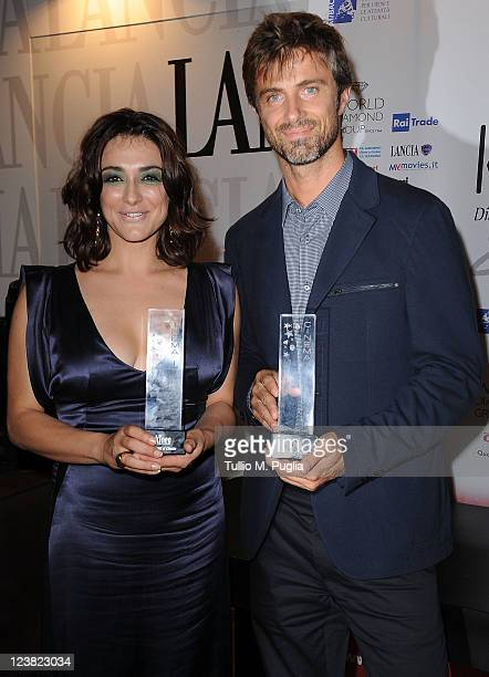 Actress Valentina Lodovini and actor Kim Rossi Stuart pose with their awards during the 'Premio Kineo' Ceremony during the 68th Venice International...