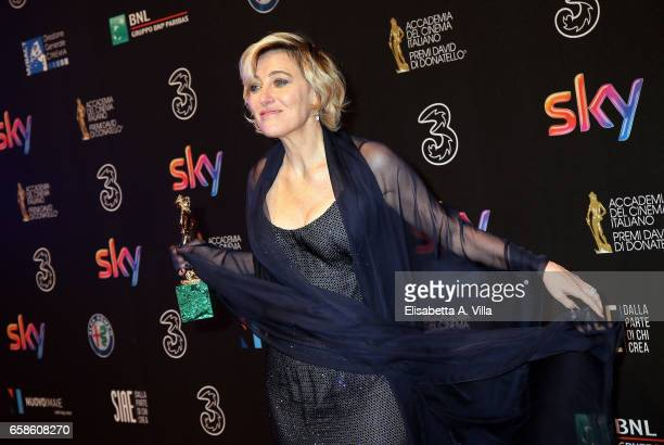Actress Valeria Bruni Tedeschi poses with her Best Actress Award at the end of the 61 David Di Donatello ceremony on March 27 2017 in Rome Italy