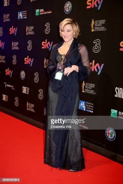Actress Valeria Bruni Tedeschi poses with her Best Actress Award during the 61 David Di Donatello ceremony on March 27 2017 in Rome Italy